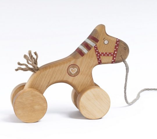 Wooden horse toy has a sensitive heart which helps him dream about a friend who would pull his sting. This handmade pull along toy is quality crafted and safe.