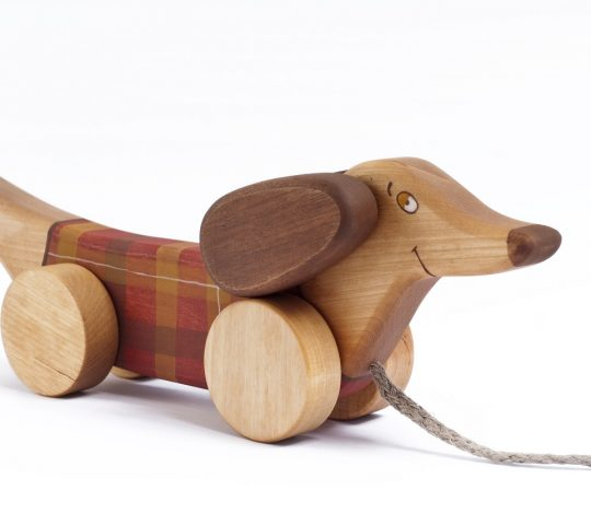 When wooden pull along dog is being pulled, he starts flapping his ears and swinging up and down with his front wheels. Handmade toy is quality crafted and safe