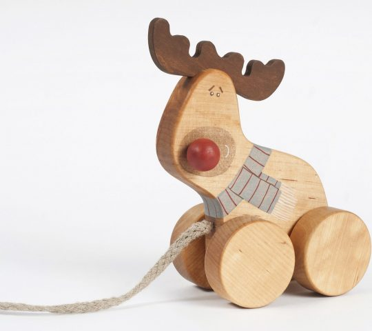 Handmade toy reindeer cannot wait until the jolly elves load its sleigh and it can visit all of you together with Santa. The toy is quality crafted and safe.